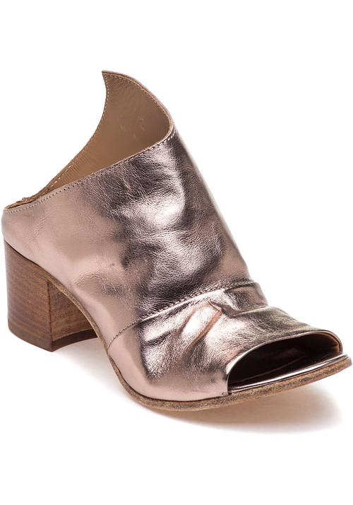 """Rock the slide trend with this fun and edgy style by 275 Central. Pair this asymmetrical style with a midi skirt for a sophisticated style. Metallic leather upper Open toe Approx. 2"""" stacked block heel Leather lining Cushioned footbed Leather soles Made in Italy"""