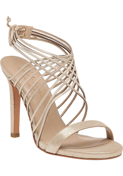 """This fabulous evening sandal by Lola Cruz features a crisscross  strappy  vamp and a unique tie closure. Dazzle under the moonlight in this stunning evening sandal.  Champagne leather upperLeather linedCushioned footbedLeather soleCrisscross vampRear tieApprox. 4.25"""" heel"""