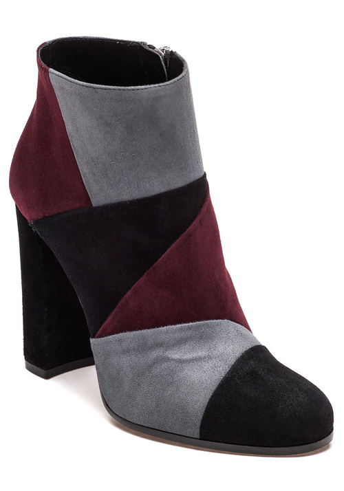 """Colorblock and patchwork is all the rage this fall. Pair this on-trend style with your favorite pair of blue jeans and a solid white top to let your shoes do all the talking.  Color block suede upper Rounded toe Approx. 3.5"""" covered heel Inside zip entry Leather lining Cushioned leather footbed Leather and rubber soles Made in Italy"""