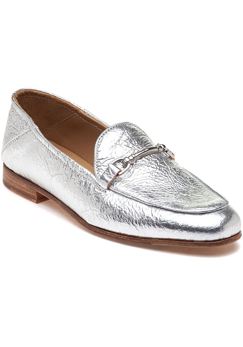 """Add a pop of silver to your favorite looks with this bold and bright loafer by 275 Central. Pair this silver style with black and white pieces to make your shoes pop! Crushed metallic leather upper Tonal bit buckle detail Leather lining Cushioned leather footbed Approx. .75"""" stacked heel Leather soles Made in Italy"""