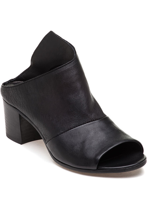 """Rock the slide trend with this fun and edgy style by 275 Central. Pair this asymmetrical style with a midi skirt for a sophisticated style. Nappa leather upper Open toe Approx. 2"""" stacked block heel Leather lining Cushioned footbed Leather soles Made in Italy"""