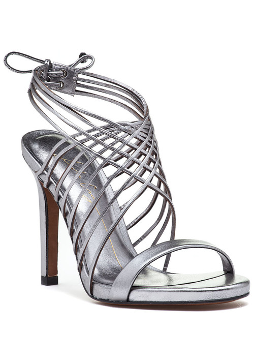"""This fabulous evening sandal by Lola Cruz features a crisscross  strappy  vamp and a unique tie closure. Dazzle under the moonlight in this stunning evening sandal.  Pewter leather upperLeather linedCushioned footbedLeather soleCrisscross vampRear tieApprox. 4.25"""" heel"""