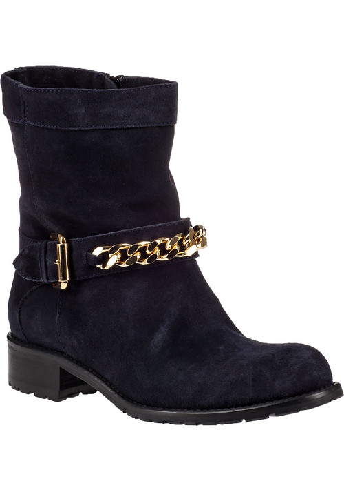 """This season  add a dash of color to your wardrobe with this lustrous blue suede boot from Jildor. The short and simple silhouette is versatile enough to pair with almost anything in your closet and the gold-tone hardware adds just the right amount of oomph!Suede upperFaux adjustable strap with gold-tone detailingFull inside zippered entryLeather liningCushioned leather footbedRubber lug soleApprox. 1.25"""" stacked heelMade in Italy"""