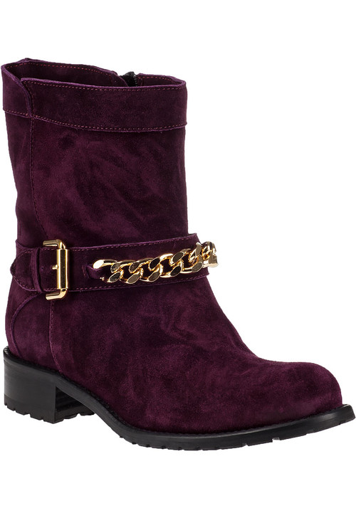 """This gorgeous Jildor ankle boot does not fall short in delivering impeccable styling. With a demure  slightly distressed suede upper  the 1377 is a little bit biker and a little bit city. Complement the fashionable hue with bold prints for a modern finish.Suede upperFaux adjustable strap with gold-tone detailingFull inside zippered entryLeather liningCushioned leather footbedRubber lug soleApprox. 1.25"""" stacked heelMade in Italy"""