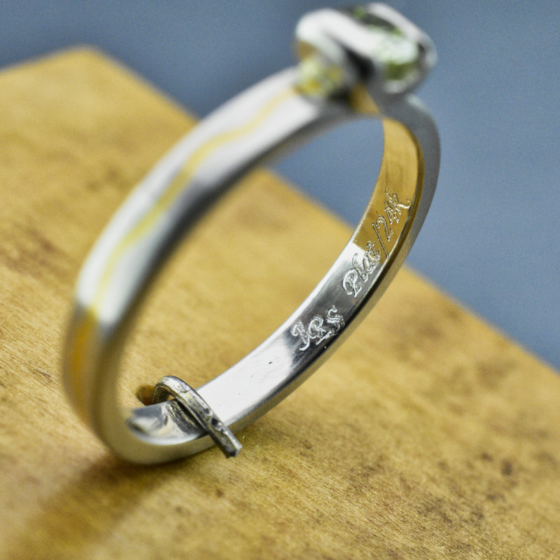 .950 Platinum Band Inlaid with 24K Gold and a .23 CT Green Diamond