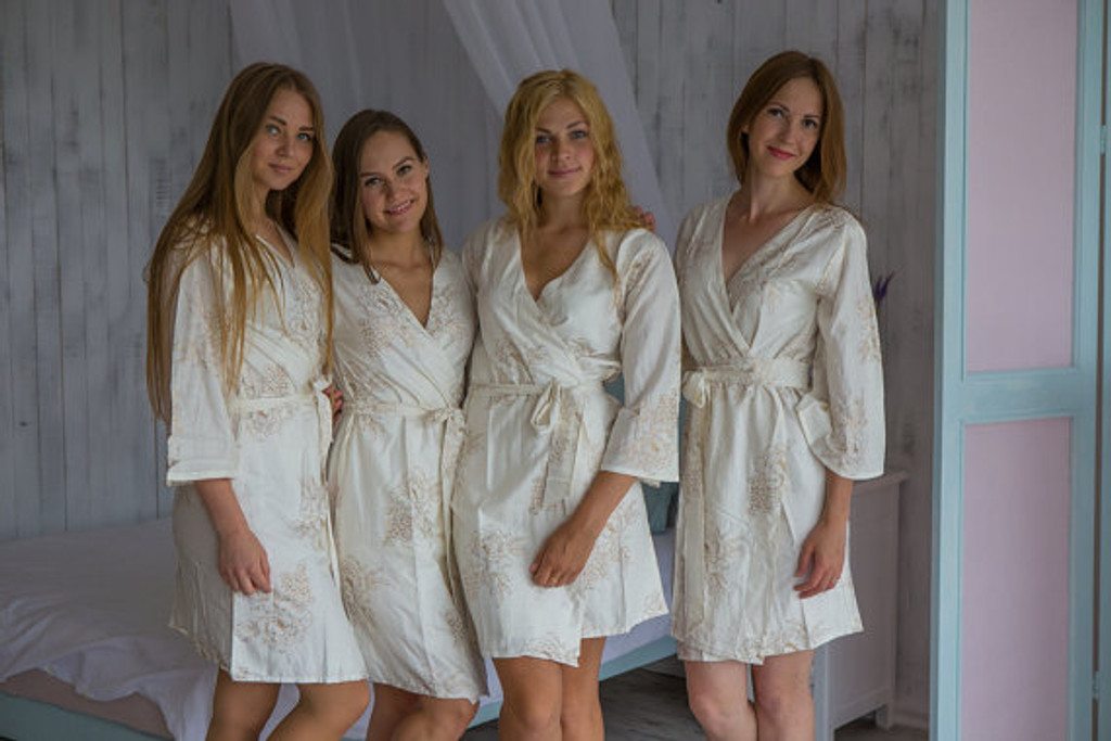 White gold bridesmaids wedding robes in floral sketch pattern