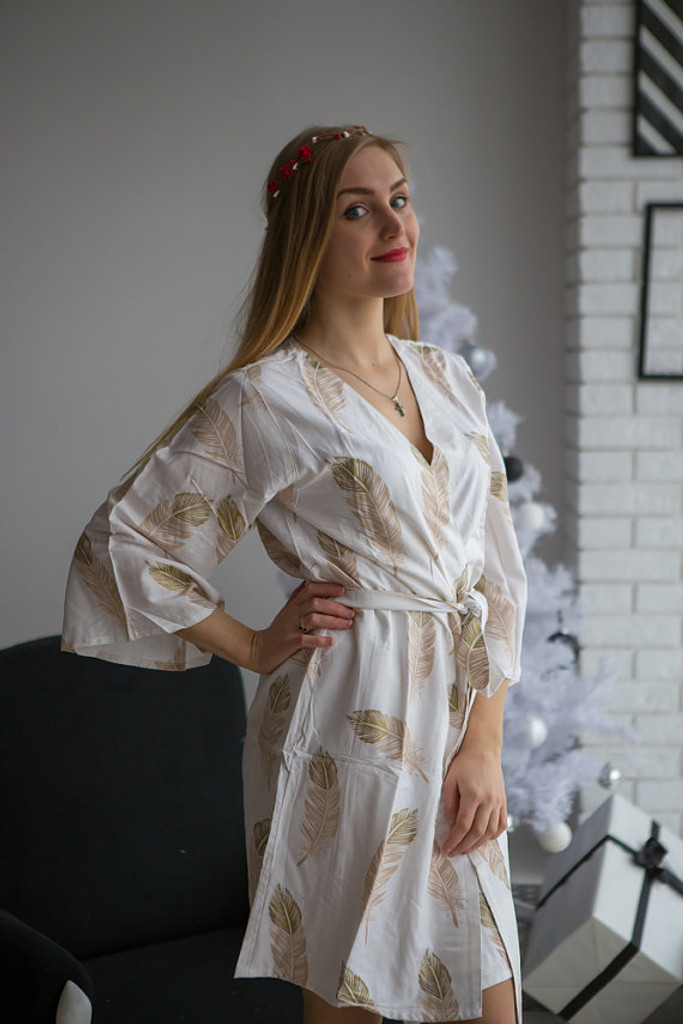 Champagne and gold wedding bridesmaids robes in feather print