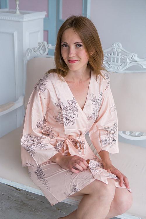 Blush bridesmaids wedding robes in floral sketch pattern
