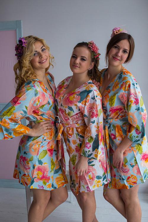Light blue bridesmaids wedding robes in her petal garden