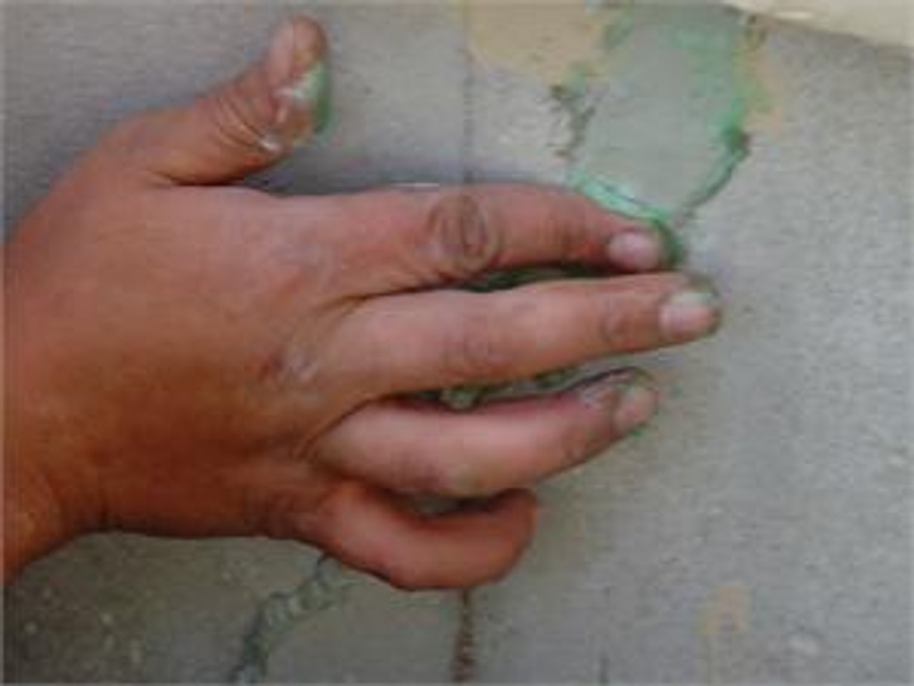 Vertical crack on a foundation wall repaired with 116 Caulk and tooled with soap on finger