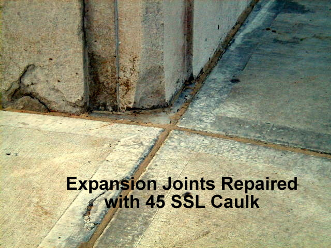 Sealed sidewalk Expansion joints with 45 SSL Caulk and finish sand