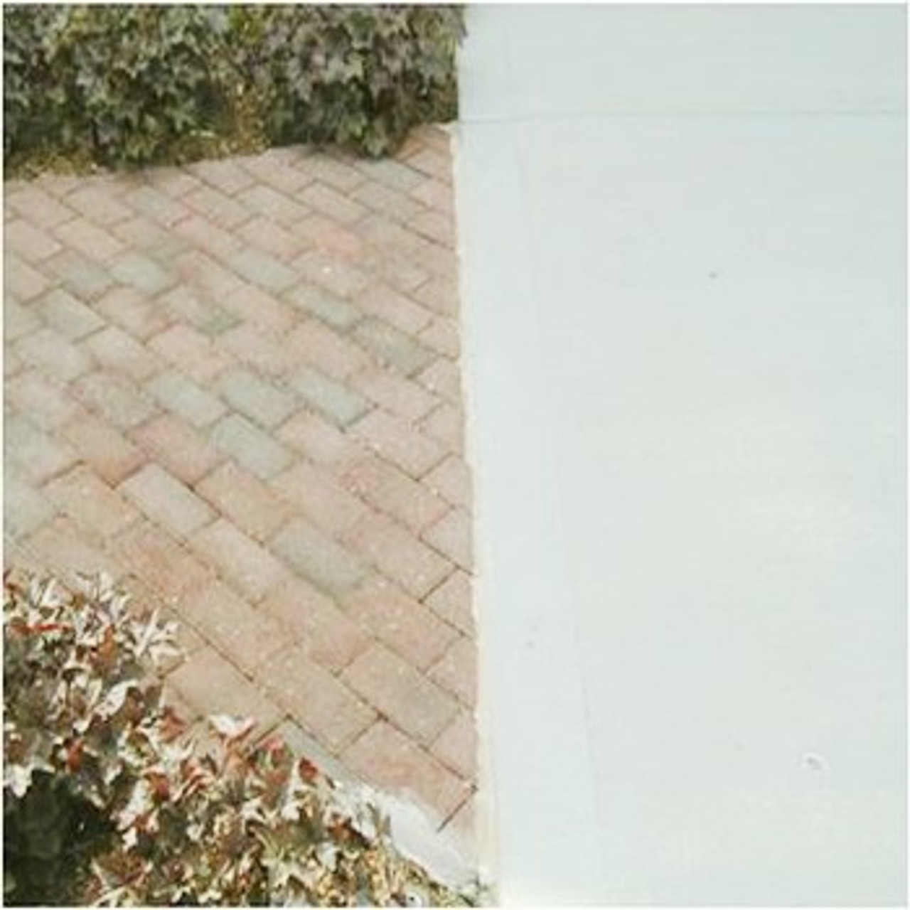 Clean and seal expansion joint between paver walkway and driveway
