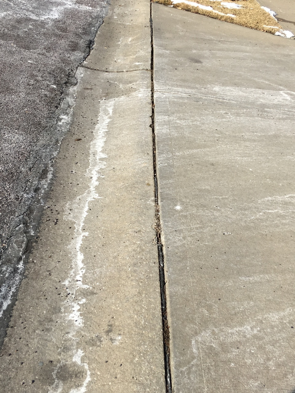 Open expansion joint allowing water to penetrate under the concrete slab