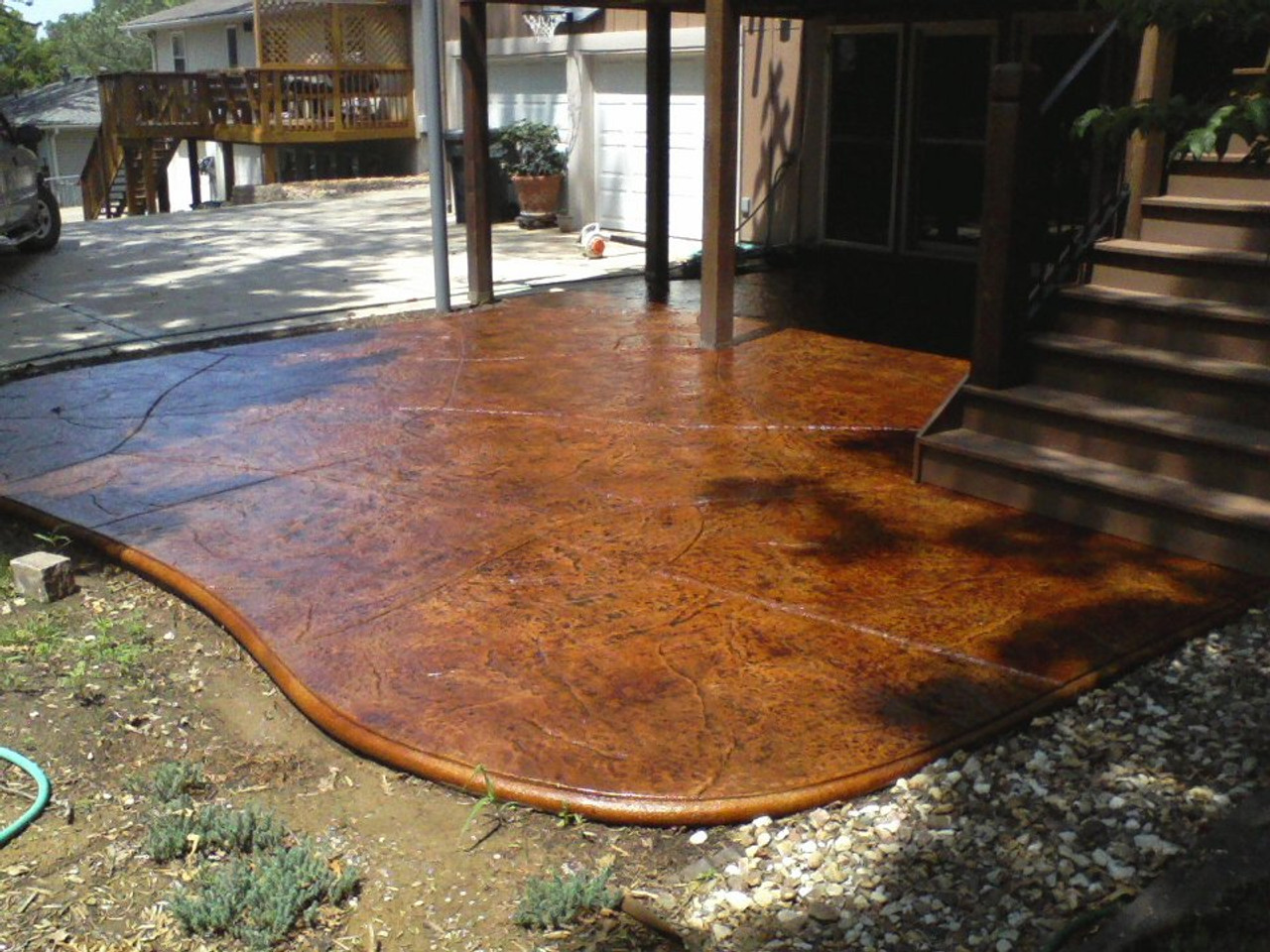 E15 Stamped Concrete Sealer enhancing the gloss of a back patio