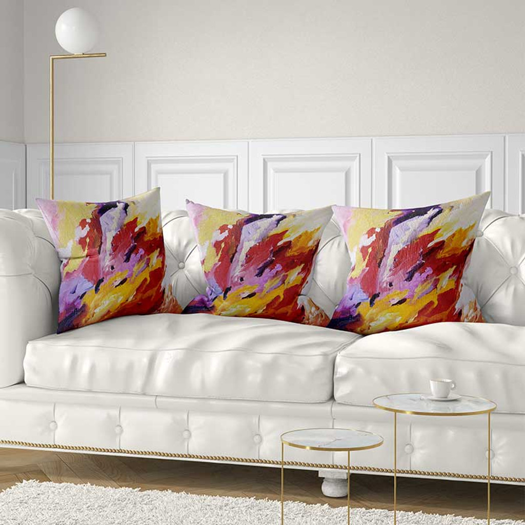 throw pillow covers with abstract art in red, purple and yellow