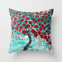 red and turquoise throw pillow with cherry tree