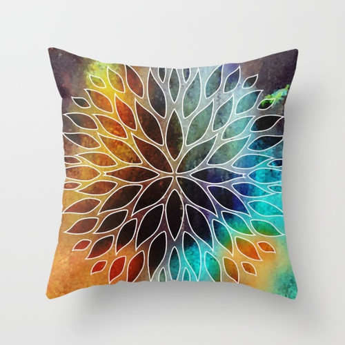 orange and turquoise throw pillow with floral design