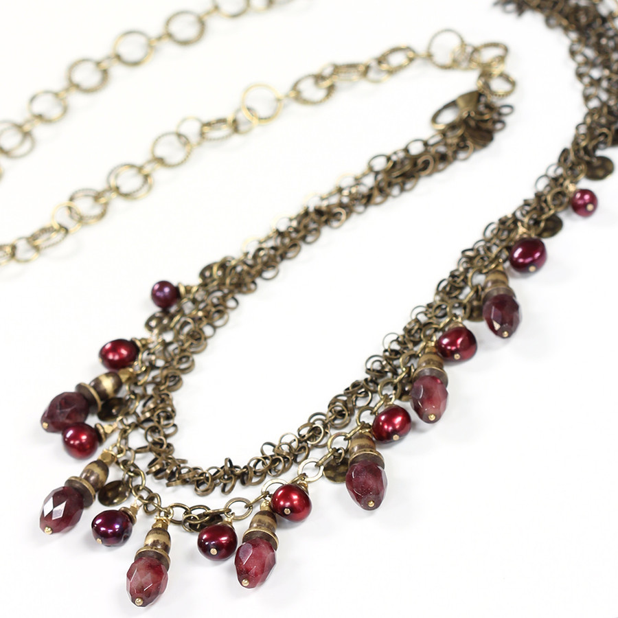 Open up to wear as longer necklace.