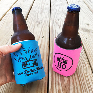 Two Dollar Radio Headquarters pink and blue koozies