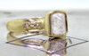 2.47 carat rough gray diamond six rough diamonds 14k yellow gold band 3/4 view on metal background with Chinchar/Maloney logo
