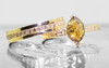 1.40 carat marquise, faceted-cut amber cognac prong set diamond ring set in 14k yellow gold with six 1.2mm brilliant champagne diamonds set in flat band.  With Eternity Wedding Band with brilliant champagne diamonds set in 14k yellow gold 4mm wide and 1.5mm thick flat band