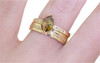 1.40 carat marquise, faceted-cut amber cognac prong set diamond ring set in 14k yellow gold with six 1.2mm brilliant champagne diamonds set in flat band.  With Eternity Wedding Band with brilliant champagne diamonds set in 14k yellow gold 4mm wide and 1.5mm thick flat band on a hand
