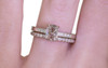 1.12 carat oval, rose cut translucent salt and pepper prong set diamond ring with six 1.2mm brilliant white diamonds set in band set in 14k white gold flat band. With Wedding Band with 16 brilliant white diamonds set in 14k white gold 1/2 round band on a hand