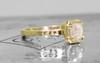 AIRA .76 carat hexagon rose cut light grayish diamond prong set in 14k yellow gold geometric octangular setting. Six 1.2mm brilliant champagne pave diamonds set in 14k yellow gold band. New Classic Collection. On metal background with Chinchar/Maloney logo.  3/4 view.