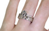 AIRA .73 carat oval rose cut smokey gray diamond prong set in 14k white gold geometric octangular setting. 1.2mm brilliant gray diamonds set in 14k white gold band. New Classic Collection. Modeled on hand with organic pave wedding band.