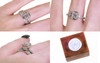 AIRA 1.05 carat oval rose cut gray diamond prong set in 14k white gold geometric octangular setting. 1.2mm brilliant gray diamonds set in 14k white gold band. New Classic Collection. Modeled on hand with organic pave wedding band. Wooden ring box with silver Chinchar/Maloney wax seal.