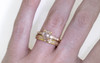 AIRA .62 carat round rose cut icy white diamond prong set in 14k yellow gold geometric octangular setting. Six 1.2mm brilliant white diamonds set in 14k yellow gold band. New Classic Collection. modeled on hand with 14k yellow gold eternity pave wedding band.