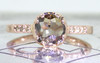 .84 carat cushion, rose cut translucent, smoky champagne prong/bezel set diamond ring with six 1.2mm brilliant champagne diamonds set into band set in 14k rose gold flat band. Front view on metal background with Chinchar/Maloney logo
