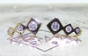 Front view on metal background with Chinchar/Maloney logo of pair of earrings.  Three square-diamond shapes in decreasing size make up the ear climber with brilliant, round gray diamonds are set into the earring also in decreasing size order.