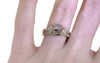 1.29 carat cushion, rose-cut translucent light champagne and pepper prong set diamond ring set in 14k yellow gold with six 2mm brilliant gray diamond clusters on each side of main setting flat band. With Wedding Band with 16 brilliant gray diamonds set in 14k yellow gold 1/2 round band on a hand