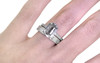 AIRA 1.58 carat long hexagon rose cut salt and pepper diamond prong set in 14k white gold geometric octangular setting. 1.2mm brilliant gray diamonds set in 14k white gold band. New Classic Collection. Modeled on hand with organic pave wedding band