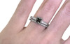 1.01 carat cushion, faceted cut dark champagne prong set diamond ring with six 1.2mm brilliant white diamonds set in band set in 14k white gold flat band. With Wedding Band with 16 brilliant white diamonds set in 14k white gold 1/2 round band on a hand