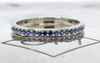 14k white gold wedding band with 16 brilliant cut blue sapphires half way around band on metal background with Chinchar/Maloney logo