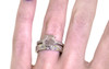 1.04 carat fancy-cut light champagne and rustic white prong set diamond ring with six 1.2mm gray diamonds set in band set in 14k white gold flat band. With Organic Wedding Band with brilliant white and gray diamonds 4mm wide and 1.5mm thick flat band on a hand