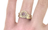 14k yellow gold wedding band with brilliant white pave in star detail with halo diamond ring modeled on hand