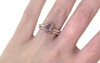 1.99 carat oval faceted cut light pink morganite with six 1.2mm brilliant white diamonds in band set in 14k rose gold flat band. with Wedding Band 16 brilliant white diamonds set in 14k rose gold on a hand