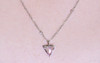 TOBA .79 carat triangle, rose-cut salt and pepper diamond necklace with two 2mm brilliant gray diamonds set into chain set in 14k white gold on a neck. Part of our New Classic Collection.