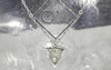 TOBA .79 carat triangle, rose-cut salt and pepper diamond necklace with two 2mm brilliant gray diamonds set into chain set in 14k white gold. Part of our New Classic Collection. Front view on metal background with Chinchar/Maloney logo