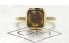 3.68 carat cushion, rose cut vivid cognac bezel set diamond ring set in 14k yellow gold with six 1.2mm brilliant champagne diamonds set in 1/2 round band. Front view on metal background with Chinchar/Maloney logo