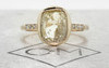 2.46 carat cushion, rose cut translucent rustic champagne/white bezel set diamond ring set in 14k yellow gold with six 1.2mm brilliant gray diamonds set in 1/2 round band. Front view on metal background with Chinchar/Maloney logo