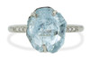 one-of-a-kind, partially hand-cut and polished, 4.04 carat sparkly and translucent, bright blue aquamarine. Prong set. Six 1.2mm brilliant white diamonds have been bead-set into the 14k recycled white gold 2mm 1/2 round band. Part of our Refined Rough Collection. Front view on white background.