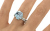 one-of-a-kind, partially hand-cut and polished, 4.04 carat sparkly and translucent, bright blue aquamarine. Prong set. Six 1.2mm brilliant white diamonds have been bead-set into the 14k recycled white gold 2mm 1/2 round band on a hand. Part of our Refined Rough Collection.
