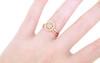 14k rose gold wedding band modeled on hand with halo diamond ring