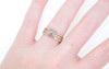 14k yellow gold wedding band with 16 brilliant champagne pave diamonds half way around band. Modeled on hand with salt and pepper diamond ring with 14k rose gold 16 brilliant champagne pave diamonds.