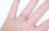 14k rose gold wedding band with 16 brilliant gray diamonds half way around band modeled on hand