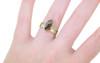14k yellow gold women's flat wedding band modeled on hand with cognac diamond ring